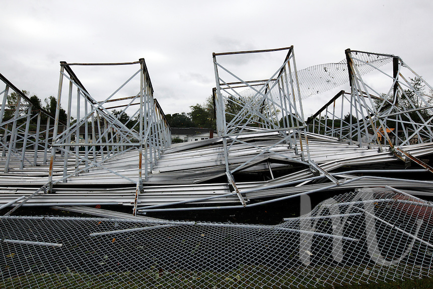 Photo By Chris Mackler: Bleachers lay in ruin on Basil Rutter Field at Athens High School in The Plains, Ohio, on the morning of Friday, Sept. 17, 2010. An unconfirmed tornado ripped through The Plains, Ohio Thursday Sept. 16, 2010, causing downed power lines, uprooted trees, overturned mobile homes and significant damage to Athens High School.
