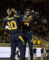 Darius Powe of California celebrates with Chris Harper of California in the air after Powe scored a touchdown during the first quarter of the game against Oregon at Memorial Stadium in Berkeley, California on November 10th, 2012.   Oregon Ducks defeated California Bears, 59-17.