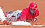 20 March 2015: Washington Nationals outfielder Tony Gwynn dives safely back to first during a Spring Training game against the Houston Astros at Osceola County Stadium in Kissimmee, Florida. The Nationals defeated the Astros 7-5 in Grapefruit League play. Mandatory Credit: Ed Wolfstein Photo *** RAW (NEF) Image File Available ***