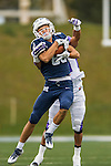 8 October 2016: Middlebury College Panther Wide Receiver Conrado Banky, a Sophomore from Katy, Texas, makes a reception before being tackled by Amherst College Defensive Back Drew Bryant, a Junior from Los Angeles, CA, at Alumni Stadium in Middlebury, Vermont. The Panthers edged out the Purple & While 27-26. Mandatory Credit: Ed Wolfstein Photo *** RAW (NEF) Image File Available ***