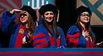 Graduates glance into the audience for a glimpse of their families and friends during the DePaul University College of Law commencement ceremony, Sunday, May 14, 2017, at the Rosemont Theatre in Rosemont, IL, where some 240 students received their Juris Doctors or Master of Laws degrees. (DePaul University/Jeff Carrion)