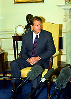 """United States Vice President Al Gore looks on as US President Bill Clinton meets with reporters in the Oval Office of the White House in Washington, DC to discuss the situation in Iraq following the two strikes by US cruise missiles against Iraqi military targets on September 4, 1996.  The President announced the attacks were successful and said that Iraqi leader Saddam Hussein """"knows there is a price to be paid for stepping over the line."""" Photo Credit: Ron Sachs/CNP/AdMedia"""