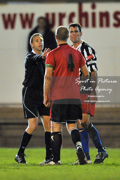 Referee Mr D Margetts steps in to seperate Elliot Styles (Hornchurch captain, 4) and Rob Haworth (Tooting captain). AFC Hornchurch Vs Tooting and Mitcham. Ryman Premier League. The Stadium. Essex. 23/11/2010. MANDATORY CREDIT Sportinpictures/Garry Bowden