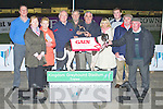 TOP DOG: William Rigney (Gains Feeds) presenting Denis Boyle owner of Killerisk Bridge winner of the Gains Feeds Sweepstake Final at the Kingdom Greyhound Stadium on Friday l-r: Kieran Casey (Race Manager KGS), Geraldine Enright, Noreen Enright, William Rigney (Gains Feeds), Tom Joe Hayes, Denis Boyle, Wayne Enright, Mossie Boyle and Bernie Boyle.