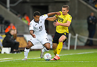 23rd November 2019; Liberty Stadium, Swansea, Glamorgan, Wales; English Football League Championship, Swansea City versus Millwall; Wayne Routledge of Swansea City and Shaun Hutchinson of Millwall jostle for the ball - Strictly Editorial Use Only. No use with unauthorized audio, video, data, fixture lists, club/league logos or 'live' services. Online in-match use limited to 120 images, no video emulation. No use in betting, games or single club/league/player publications