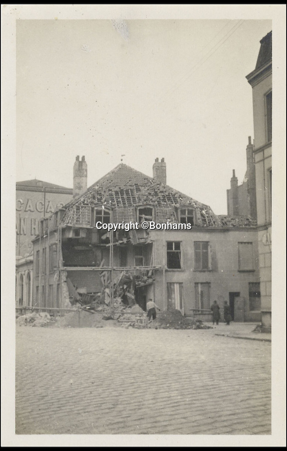 BNPS.co.uk (01202 558833)<br /> Pic: Bonhams/BNPS<br /> <br /> ***Please Use Full Byline***<br /> <br /> Ruined house, Dunkirk, April 1915, taken by the Prince of Wales. <br /> <br /> <br /> <br /> A remarkable album of photographs taken by the future King Edward VIII during a 'sight seeing' tour of the Western Front 99 years ago has come to light.<br /> <br /> Edward, Prince of Wales, took his own camera with him on his morale-boosting visit to the front-line in France in 1915.<br /> <br /> The young Royal took scores of snaps which included a gang of captured German soldiers, shell holes, bomb damaged buildings and British troops practising throwing hand grenades.<br /> <br /> He also snapped numerous Army officers he met on the visit and posed for several photos as well.