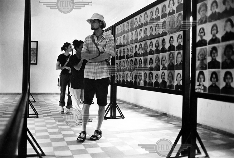 Tourists at Tuol Sleng museum, formerly the S-21 Khmer Rouge detention centre. The Khmer photographed every prisoner before they were killed - over 16,000 inmates died.