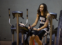 Jun. 10, 2013; Phoenix, AZ, USA: Phoenix Mercury center Brittney Griner rides an exercise bike during a team practice at the US Airways Center. Mandatory Credit: Mark J. Rebilas-