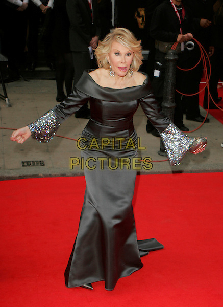 JOAN RIVERS.Red Carpet Arrivals at The British Academy Television Awards (BAFTA's) Sponsored by Pioneer, held at the London Palladium, London, England, May 20th 2007. .full length black off the shoulder dress arms funny.CAP/AH.©Adam Houghton/Capital Pictures.