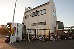 Mar. 13, 2011 - Ibaraki, Japan - A vehicle is shown flipped over in front of a office building in Oarai two days after the 8.9 magnitude earthquake struck followed by a tsunami that hit the north-eastern region. The death toll is currently unknown with casualties that may run well into the thousands.
