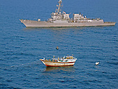 The guided-missile destroyer USS Kidd (DDG 100) responds to a distress call from the master of the Iranian-flagged fishing dhow Al Molai, who claimed he was being held captive by pirates in the Arabian Sea on Thursday, January 5, 2012.  Kidd's visit, board, search and seizure team, boarded and detained 15 suspected pirates, who were reportedly holding the 13-member Iranian crew hostage for the last two months.  Kidd is conducting counter-piracy and maritime security operations while deployed to the U.S. 5th Fleet area of responsibility. .Credit: U.S. Navy via CNP