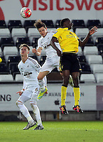 Pictured: Aaron Lewis of Swansea (C) heads the ball away Monday 25 April 2016<br /> Re: Play Off semi final, Swansea City AFC U21 v Aston Villa FC U21 at the Liberty Stadium, Swansea, UK