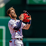 14 April 2018: Washington Nationals outfielder Bryce Harper re-dons his batting helmet after hitting a double in the first inning against the Colorado Rockies at Nationals Park in Washington, DC. The Nationals rallied to defeat the Rockies 6-2 in the 3rd game of their 4-game series. Mandatory Credit: Ed Wolfstein Photo *** RAW (NEF) Image File Available ***