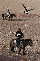 Kazakh men at eagle festival