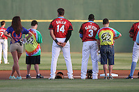 Myrtle Beach Pelicans infielders Joey Gallo #14 and Hanser Alberto #3 standing for the national anthem with fans on Special Olympics night before a game against the Salem Red Sox at Ticketreturn.com Field at Pelicans Ballpark on April 5, 2014 in Myrtle Beach, South Carolina. Salem defeated Myrtle Beach 5-2. (Robert Gurganus/Four Seam Images)