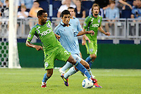 James Riley (7) defender Seattle Sounders shields the ball from Jeferson (10)  midfielder Sporting KC,.... Sporting Kansas City were defeated 1-2 by Seattle Sounders at LIVESTRONG Sporting Park, Kansas City, Kansas.