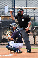 Umpire J.C. Velez makes a call behind catcher Jesus Aparicio during a game between the GCL Braves and GCL Yankees 2 on June 23, 2014 at the Yankees Minor League Complex in Tampa, Florida.  GCL Yankees 2 defeated the GCL Braves 12-4.  (Mike Janes/Four Seam Images)