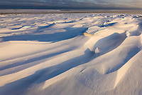Zastrugi, wind blown snow on Barter Island, Beaufort sea in the distance, arctic, Alaska