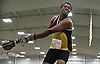 Wonder Louis of Uniondale spins to generate momentum for a weight throw during the event's Nassau County championship and state qualifier at St. Anthony's High School on Monday, Feb. 6, 2017.