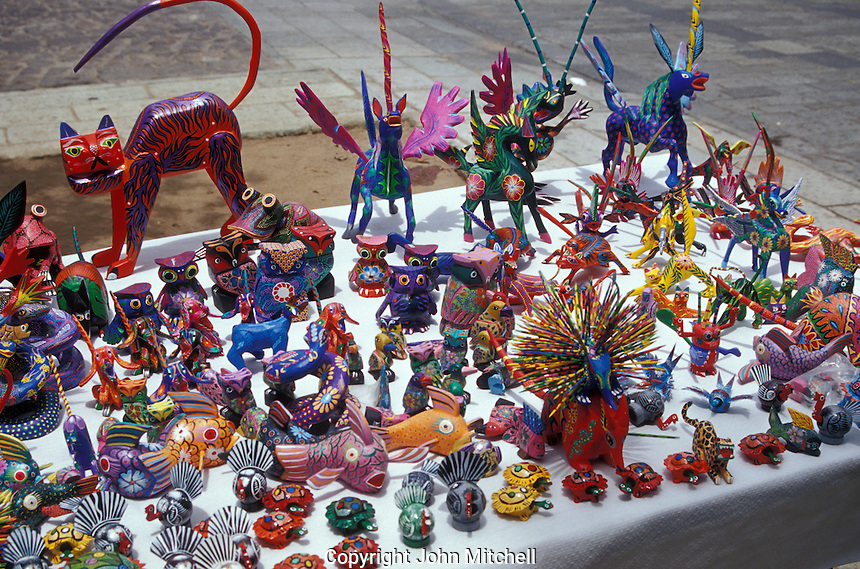 Whimsical carved wooden animals known as alebrijes for sale in the city of Oaxaca, Mexico