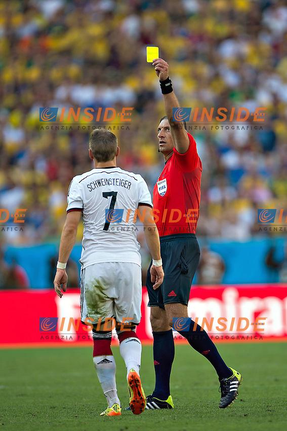 Bastian Schweinsteiger of Germany ammonito da Referee Nstor Pitana