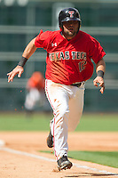 Eric Gutierrez #12 of the Texas Tech Red Raiders hustles down the third base line to score a run against the Sam Houston State Bearkats at Minute Maid Park on March 1, 2014 in Houston, Texas.  The Bearkats defeated the Red Raiders 10-6.  (Brian Westerholt/Four Seam Images)