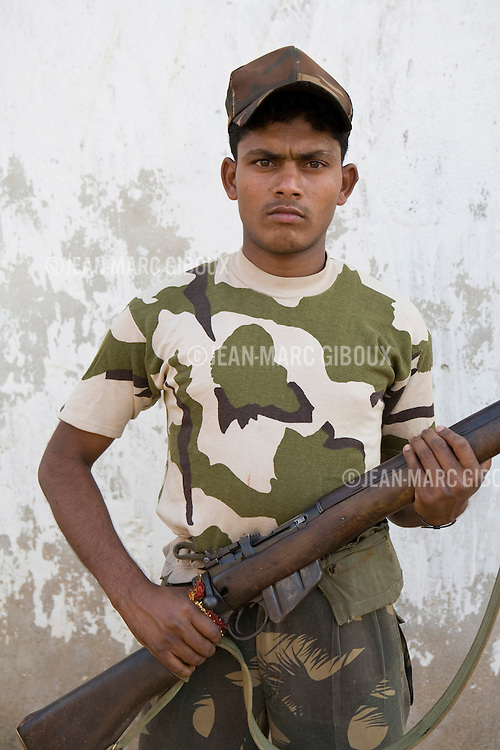 """ERABORE, DANTEWARA DISTRICT, CHHATTISGARH, INDIA, MARCH 4, 2008 : Training exercise , patrol with the SPOs, Special Police Officers that are the armed wing of the anti Naxalite Salwa Judum. The Maoist insurgency called Naxalites have been waging a war against the government for the past 25 years and has been gaining momentum in in the past few years. They are present in some 150 of the 600 districts of India, and Dantewara is one of Chhattisgarh rural Maoist stronghold where they control most of the countryside. The overwhelmed police force is hiring more personel to deal with the Naxalite threat and the Government has armed civil defence anti-naxalite milicias to take on the naxalites , emptying villages to cut local support to the rebels. The movement called """"Salwa Judum"""" (campaign for peace) in the  started in june 2005 when some villages took a stand against the Maoists, but it is now dragging the whole district into the bloody civil war, at the expense of the  local tribal villagers caught in the middle, making it the deadliest theater of the naxal war. The conflict has claimed over 900 lives in 2006 and again in 2007, and some 50 to 60,000 people live in makeshift camps, displaced from their ancestral villages, protected by the Salwa Judum and the police force. But for the tribals who do not want to leave their home and farming fields, there are no government service in Naxalite controled areas, meaning no health care or education for the children.  (Photo by Jean-Marc Giboux/ GettyImages)"""