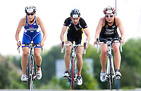 08 AUG 2010 - LONDON, GBR - Elinor Thorogood (left) and Lucy Smith (right) reach the brow of a hill during the Junior womens race along with an age group competitor at the  2010 Challenger World London Triathlon (PHOTO (C) NIGEL FARROW)