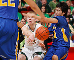 RAPID CITY, S.D. MARCH 20, 2015 -- Brayden McNeary #23 of Aberdeen Roncalli passes around Donte Shangreaux #10 of Little Wound during their semi-final game at the 2015 South Dakota State A Boys Basketball Tournament at the Don Barnett Arena in Rapid City, S.D.  (Photo by Dick Carlson/Inertia)