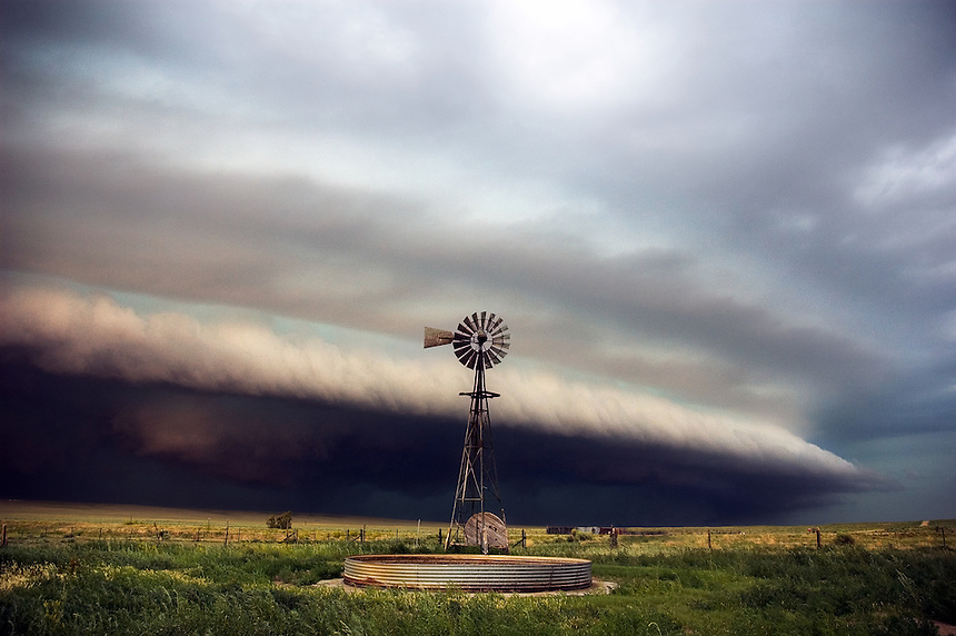 A lone windmill stands sentry as a shelf cloud heralds the approach of severe thunderstorms to the plains of eastern Colorado in June.