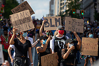 Protesters carry signs during a march against police brutality and racism in Washington, D.C. on Saturday, June 6, 2020.<br /> Credit: Amanda Andrade-Rhoades / CNP/AdMedia