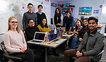 "Team members of DePaul University's Innovation Development Lab (iD Lab), Friday, Feb. 15, 2019. Housed in the College of Computing and Digital Media, the iD Lab ""helps companies bring creative, innovative ideas to life."" The lab focuses on development, design and data analytics to help real companies succeed. (DePaul University/Jeff Carrion)"