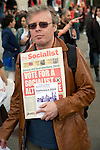 May Day march and rally at Trafalgar Square, May 1st, 2010 Man holding Socialist Party newspaper 'The Socialist'