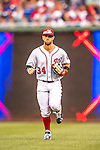 15 June 2016: Washington Nationals outfielder Bryce Harper trots back to the dugout during game action against the Chicago Cubs at Nationals Park in Washington, DC. The Nationals defeated the Cubs 5-4 in 12 innings to take the rubber match of their 3-game series. Mandatory Credit: Ed Wolfstein Photo *** RAW (NEF) Image File Available ***