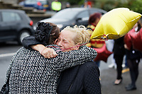 Pictured: Two women embrace each other outside St John Lloyd School, in Llanelli, Carmarthenshire, UK. Thursday 12 September 2019<br /> Re: The family of a bullied pupil were joined by friends and held a minute's silence, a year after he hanged himself in school toilets.<br /> His heartbroken father Byron John claims his son Bradley, 14, would still be alive if the school had acted to stop the bullies.<br /> Bradley's 13-year-old sister Danielle found him dead in the toilet block at, an hour after going missing at St John Lloyd Roman Catholic School in Llanelli, South Wales, UK.