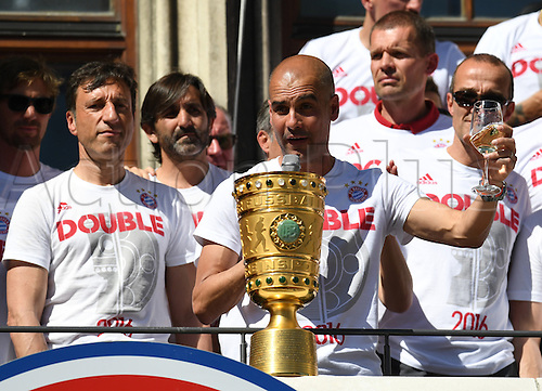 22.05.2016. Munich, Germany.  Munich's head coach Josep 'Pep' Guardiola (C) celebrates next to the DFBCup trophy at the reception held for DFBCup winner FCBayern Munich at the city hall in Munich, Germany, 22 May 2016. FCBayern Munich defeated Borussia Dortmund 4-3 on penalties in the DFBCup final held on 21 May.