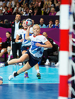 28 JUL 2012 - LONDON, GBR - Nina Heglund (GBR) of Great Britain shoots during the women's London 2012 Olympic Games Preliminary round handball match against Montenegro at The Copper Box in the Olympic Park, in Stratford, London, Great Britain .(PHOTO (C) 2012 NIGEL FARROW)