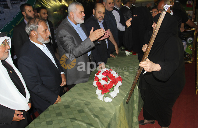Senior Hamas leader Ismail Haniyeh attends a ceremony organised by his movement to honor the relatives of who killed by Israel during the summer's fierce offensive, in Khan Younis in the southern Gaza Strip, October 23, 2014. Photo by Ramadan El-Agha