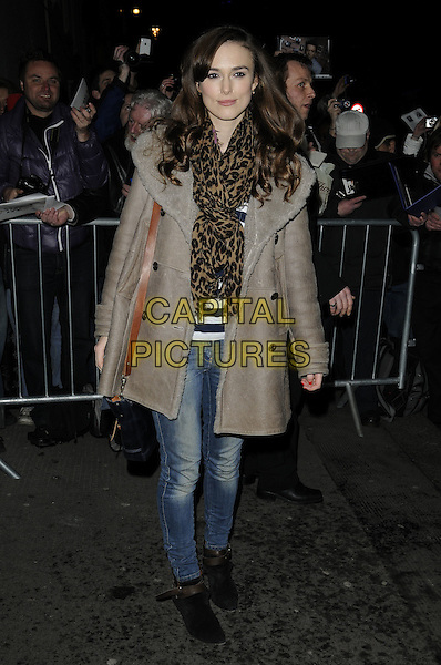 "KEIRA KNIGHTLEY.Leaving after the evening performance of ""The Misanthrope"", Comedy Theatre, London, England, UK, March 12th 2010..full length brown louis vuitton animal leopard print scarf beige grey gray sheepskin coat jeans ankle boots suede shoulder bag striped top navy blue and white black .CAP/CAN.©Can Nguyen/Capital Pictures"