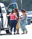 "www.AbilityFilms.com.805-427-3519.AbilityFilms@yahoo.com...April 18th 2012..""Desperate Housewives tv show Filming in Los Angeles "".Vanessa Williams wearing a brown & yellow tie dye dress wedding dress walking with Eva Longoria in a purple & blue  gown leaving the Macy department store in Los Angeles."