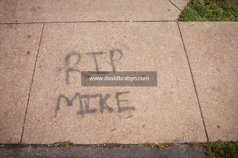 HSUL 20140819 United States, Ferguson, MO. Writing on the sidewalk near the memorial to Michael Brown on Canfield Drive in Ferguson, MO, on August 19, 2014, at the spot where he was killed. Photographer: David Brabyn