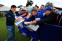 Rory McIlroy (EUR) signing autography after the Team pictures ahead of the 2014 Ryder Cup at Gleneagles. The 40th Ryder Cup is being played over the PGA Centenary Course at The Gleneagles Hotel, Perthshire from 26th to 28th September 2014.: Picture Fran Caffrey, www.golffile.ie: 23-Sep-14