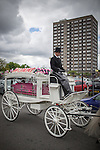 © Joel Goodman - 07973 332324 . 09/08/2013 . Salford , UK . The pink coffin is taken from the church by a horse drawn hearse following the service . The funeral of Linzi Ashton at St Paul's C of E Church in Salford , today (9th August 2013) . Linzi Ashton (25) was found murdered in her home on Westbourne Road in Salford on 29th June . Michael Cope is standing trial, accused of murdering, raping and assaulting her . Photo credit : Joel Goodman