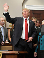 United States President Donald J. Trump waves after signing an Executive Order to promote healthcare choice and competition in the Roosevelt Room of the White House in Washington, DC on Thursday, October 12, 2017.  The President's controversial plan is designed to make lower-premium health insurance plans more widely available.<br /> Credit: Ron Sachs / Pool via CNP /MediaPunch