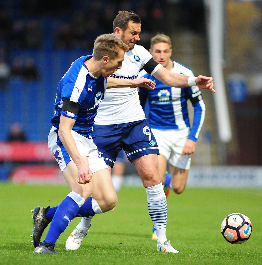 Wycombe Wanderers' Paul Hayes vies for possession with Chesterfield's Tom Anderson<br /> <br /> Photographer Andrew Vaughan/CameraSport<br /> <br /> The Emirates FA Cup Second Round - Chesterfield v Wycombe Wanderers - Saturday 3rd December 2016 - Proact Stadium - Chesterfield<br />  <br /> World Copyright &copy; 2016 CameraSport. All rights reserved. 43 Linden Ave. Countesthorpe. Leicester. England. LE8 5PG - Tel: +44 (0) 116 277 4147 - admin@camerasport.com - www.camerasport.com