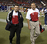 2 October 2004: United head coach Peter Nowak (left) and assistant Tom Soehn (right) make their way to the bench before the game. DC United defeated the MetroStars 1-0 at Giants Stadium in East Rutherford, NJ during a regular season Major League Soccer game..