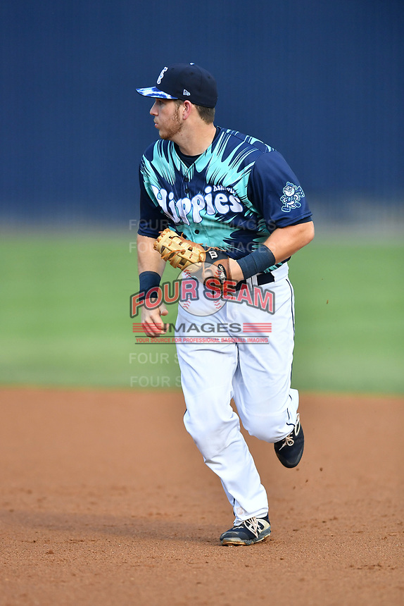 Asheville Tourists first baseman Grant Lavigne (34) reacts to the ball during a game against the Greenville Drive on Hippie Night at McCormick Field on July 11, 2019 in Asheville, North Carolina. The Drive defeated the Tourists 6-2. (Tony Farlow/Four Seam Images)
