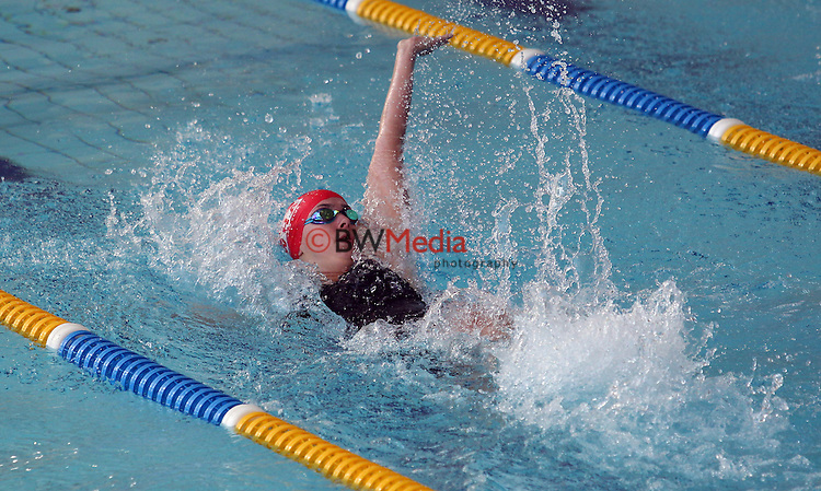 An athlete begins the Back-stroke event during the Swimming New Zealand Division II Championships, Moana Pool, Dunedin, Friday 20 March 2015. Photo: Rob Jefferies/www.bwmedia.co.nz