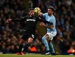 Manuel Lanzini of West Ham United battles for possession with Kyle Walker of Manchester City during the premier league match at the Etihad Stadium, Manchester. Picture date 3rd December 2017. Picture credit should read: Andrew Yates/Sportimage