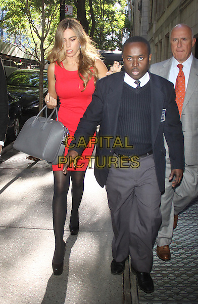 Sofia Vergara <br /> seen at Live with Kelly and Micheal in New York City, NY, USA.<br /> September 25th, 2013<br /> viagra full length red dress grey gray bag purse black tights minder security bodyguard tall short hand on shoulders <br /> CAP/MPC/RW<br /> &copy;RW/ MediaPunch/Capital Pictures